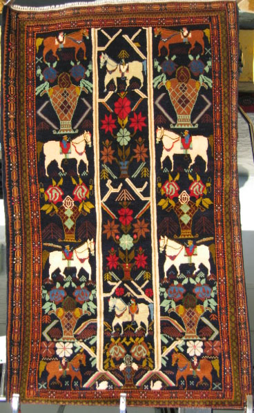 Afghan war rug with subtle weapons
