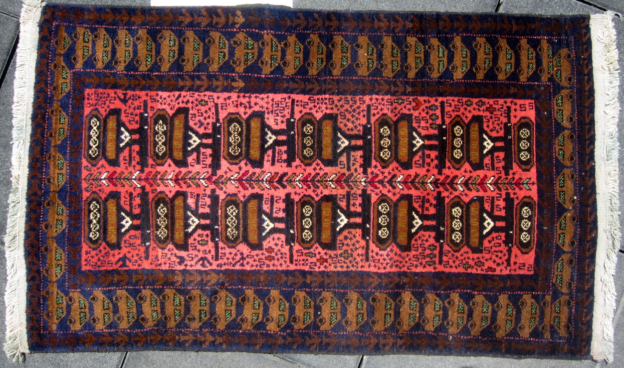 Afghan war rug with obvious weapons