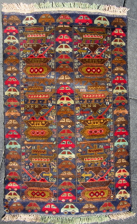 Blue rug with brightly colored car trim and S shapes throughout