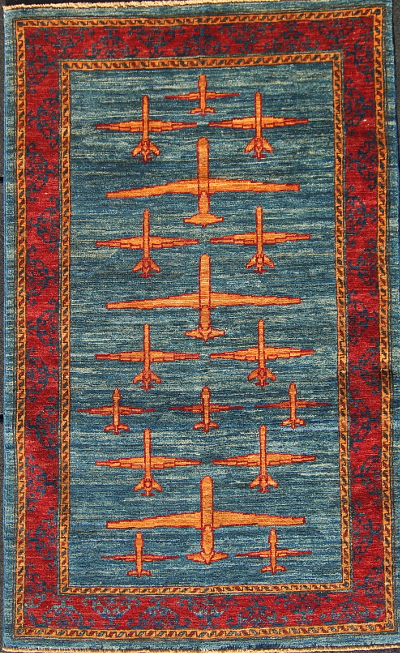 Three Drone Afghan War Rug with Ochre Planes
